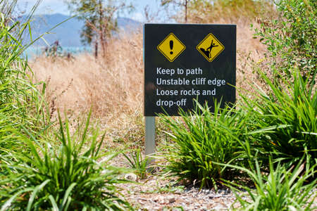 unstable: Australian warning sign keep to path unstable cliff edge Stock Photo
