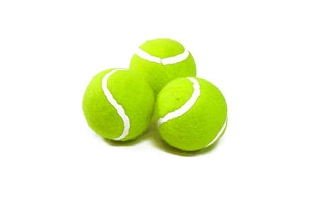 Three tennis balls in the form of a triangle close up photo
