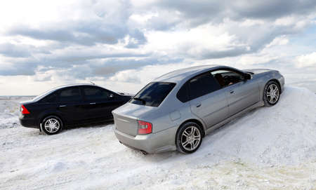Two cars on snow photo