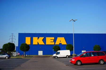 ikea: POZNAN, POLAND - AUGUST 01, 2015: Parked cars on a parking lot in front of a IKEA building in Poznan, Poland