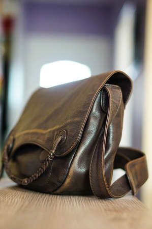 leather bag: Leather bag on wooden table