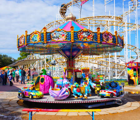 morskie: USTRONIE MORSKIE, POLAND - JULY 20, 2015: Colorful child carousel on a sunny day
