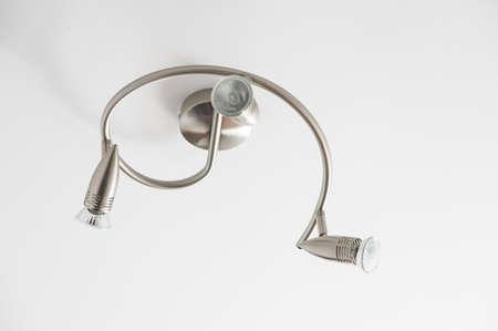 halogen: Modern curved halogen lamp on a ceiling