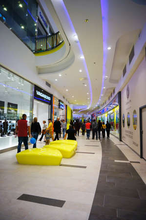 poznan: POZNAN, POLAND - OCTOBER 26, 2013: People passing stores in the Poznan City Center shopping mall