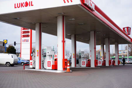 fuel pumps: POZNAN, POLAND - MARCH 18, 2014: Fuel pumps of a Lukoil tank station at the Zamenhofa street