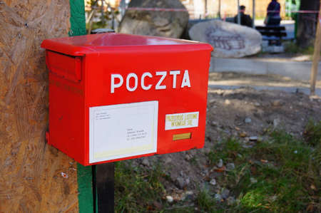 adress: Red mail box with information