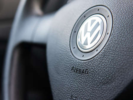 shiny car: POZNAN, POLAND - FEBRUARY 17, 2013: Volkswagen logo on a steering wheel