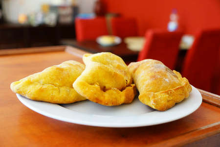 argentinian: Argentinian empanadas served on a white plate