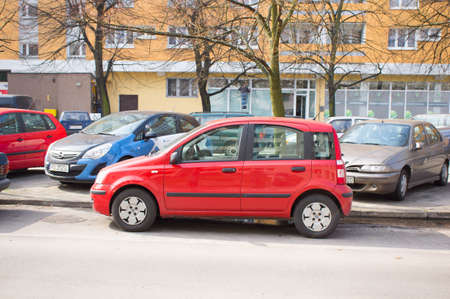 fiat: POZNAN, POLAND - MARCH 28, 2014: Parked red Fiat Panda at a parking lot by a apartment block