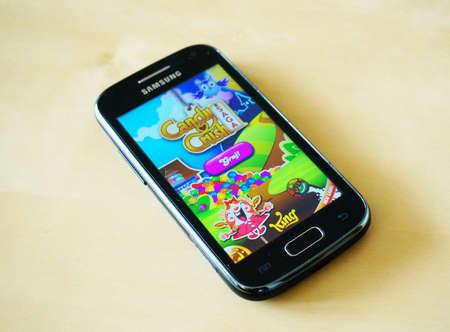 saga: POZNAN, POLAND - MARCH 21, 2014: Candy Crush Saga game on a Samsung smartphone