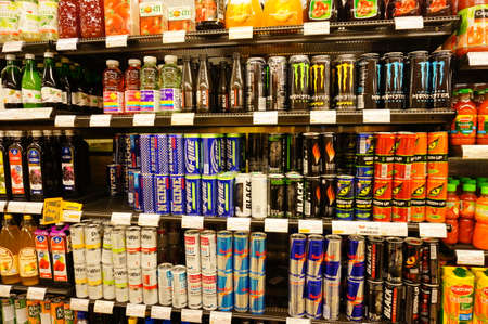 energy drinks: POZNAN, POLAND - JANUARY 27, 2014: Variation of energy drinks in a supermarket Editorial