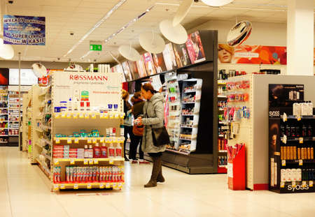 costumers: POZNAN, POLAND - MARCH 18, 2014: Clients choosing products in a Rossmann store