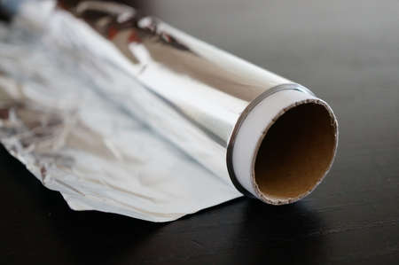 foil roll: Roll of silver aluminum foil Stock Photo
