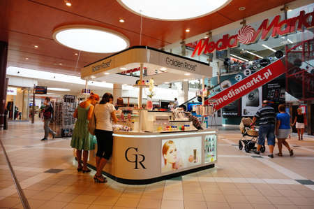 costumers: POZNAN, POLAND - AUGUST 17, 2013: Cosmetics stand in the King Cross shopping mall