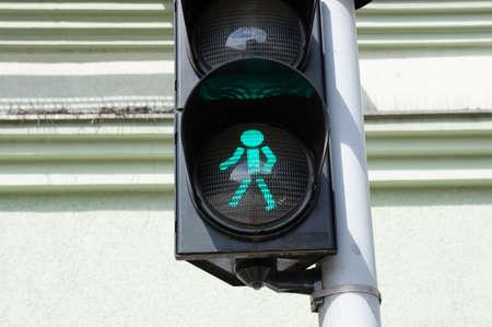 pedestrians: Traffic light showing green for pedestrians