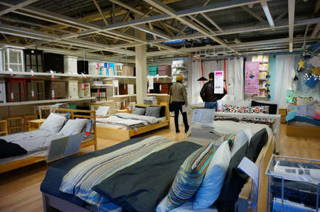 costumers: POZNAN, POLAND - NOVEMBER 24, 2013: Clients looking at beds in a Ikea furniture store Editorial