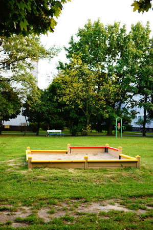 play ground: Sand box on grass at a play ground