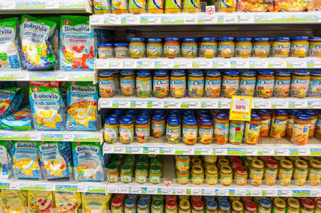 shelfs: GDYNIA, POLAND - JUNE 14, 2014: Variation of food in bags and jars for sale on shelfs in a Rossmann supermarket