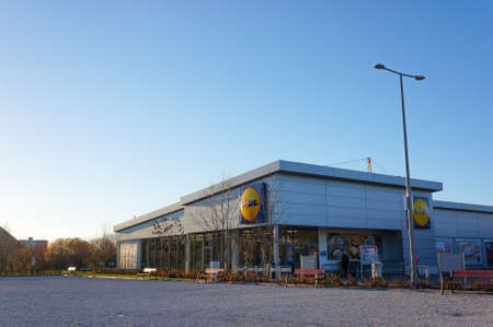 retailing: POZNAN, POLAND - NOVEMBER 08, 2015: Exterior of a new Lidl grocery store with recreation area