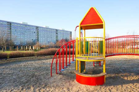 apartment blocks: Climbing equipment on a playground by apartment blocks Stock Photo