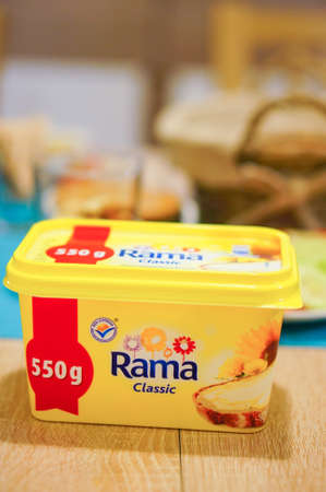 margarine: POZNAN, POLAND - JANUARY 16, 2015: Pack of Rama Classic margarine standing on table