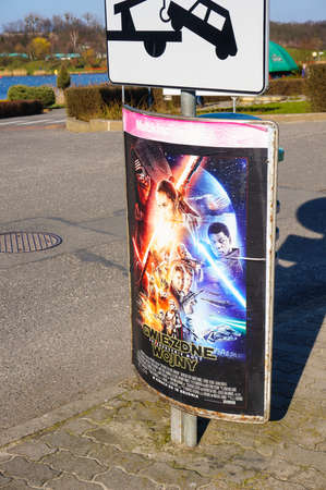 movie poster: POZNAN, POLAND - MARCH 27, 2016: Star Wars movie poster on a sign at the Malta park Editorial