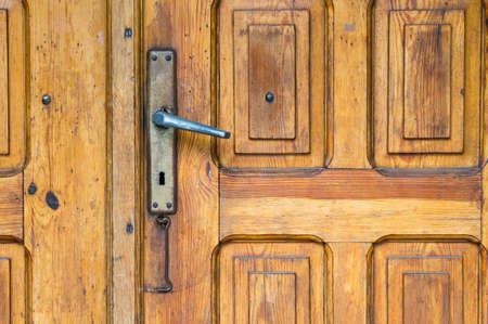 door handle: Close up of a classic closed wooden door with metal handle Stock Photo