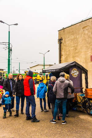 Poznan, Poland - November 25, 2018: Group of people standing in front of a Bike Cafe stand during the MPK Katarzynki event.