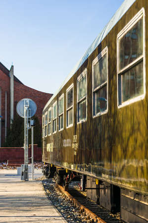 Poznan, Poland - January 19, 2019: Close up of a old exhibition train wagon standing on the Rataje park. Exposition is recently build as a attraction. Zdjęcie Seryjne - 122360302