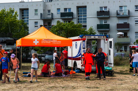 Poznan, Poland - June 9, 2018: Ambulance workers giving first aid instructions during the Bezpieczne Wakacje event on the local fire department area Sajtókép