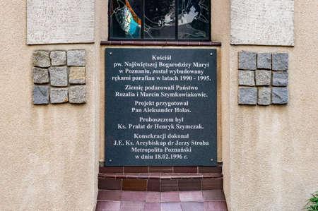Poznan, Poland - September 15, 2018: Plate with text on the Najswietszej Bogarodzicy Maryi church in the Stare Zegrze district
