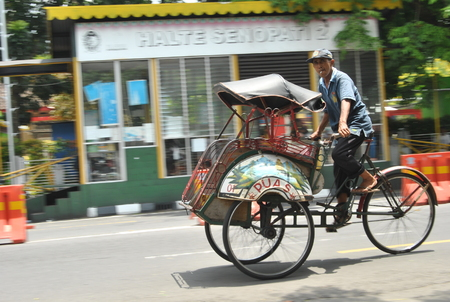 Pedicab is one of the means of transportation that is still on guard sustainability in yogyakarta, in addition to the transportation of pedicab  goods also in use as a tour for the city of Yogyakarta Editorial