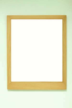 golden brown wood frame on the wall photo