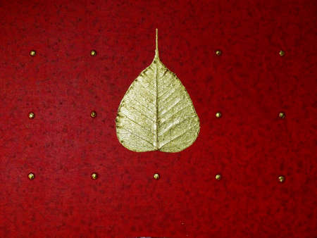 peepal tree: gold leaf over red background
