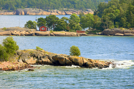 Aland archipelago in  Baltic Sea with thousands of tiny rocky islands formed of red granite  Stock Photo