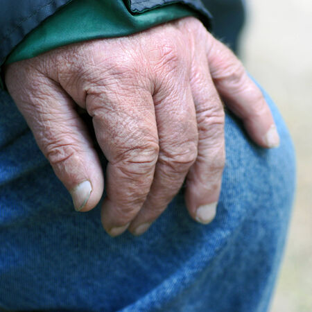 nurseryman: senior woman�s hand leaning on knee in resting situation