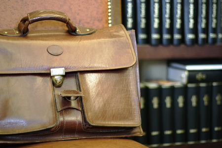 law office with leather briefcase and law books