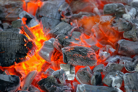 out of production: Burning charcoal, preparation for outdoor cooking.