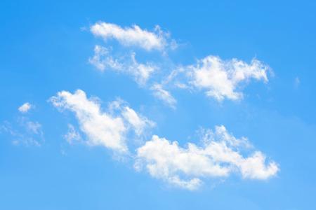 twain: Four twain clouds in lucid blue sky.