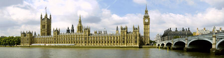 two famous landmarks of London with Westminster bridge in panoramic view photo