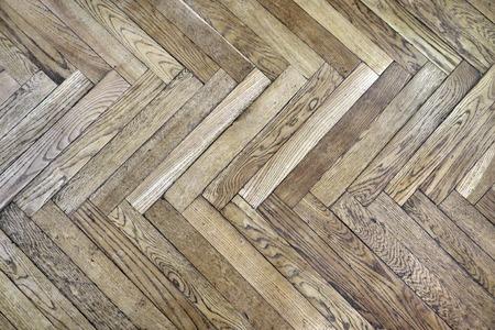 Single herringbone style parquet made of oak wood  photo