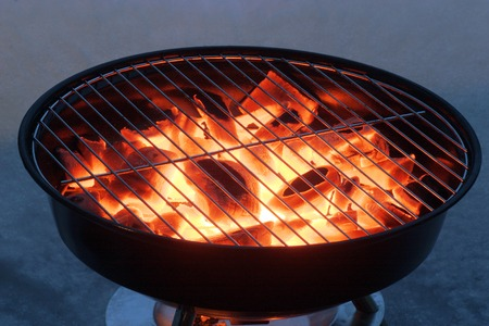 barbecuing: Grill pot with flame, preparation for  barbecuing  Stock Photo