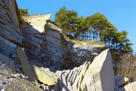 landfall: coastal cliff with break off limestone chunks, location Pakri in Estonia