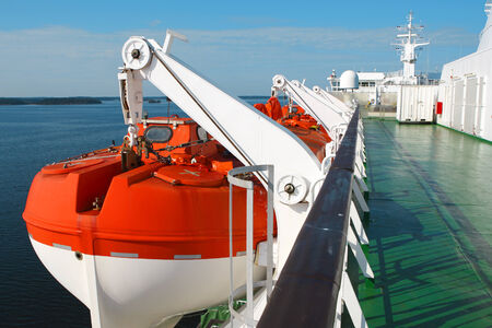 life boat on cruise ship for emergency situation photo