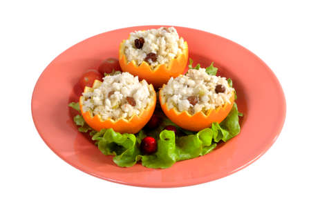 rice pudding with raisins in jagged orange shells photo