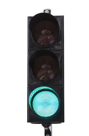 green traffic light illuminated, isolated on white background