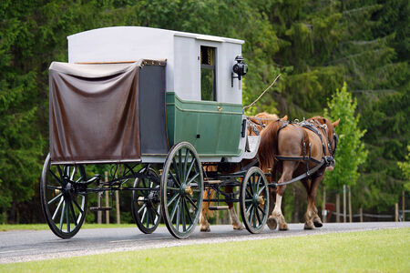 19th century: Horse powered vintage stage-coach  built at end of 19th century on the road  Stock Photo