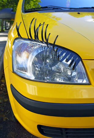 Yellow female car with seductive eyelash.