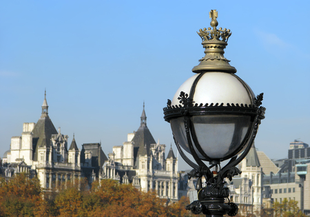 regalia: Street lamp with regalia design and Victorian Gothic style building in background.