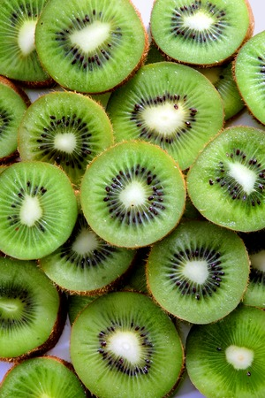 kiwis: kiwi wheels show its beautiful structure  forming a green colorful pattern Stock Photo